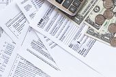 Us Tax Forms.tax Forms Background. The Concept Of Tax Settlement. Tax Forms Background. The Concept  poster