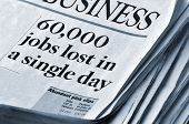 Layoffs and Recession Themes - business section of newspaper with headlines '60,000 jobs lost in a s