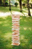 Close Up Blocks Wood Game. Giant Outdoor Block Game. The Tower From Wooden Blocks. poster