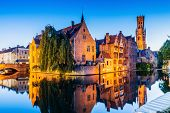 Bruges, Belgium. The Rozenhoedkaai Canal In Bruges With The Belfry In The Background. poster