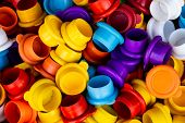 Numerous Rubber Caps Of Different Colors. Grouping Of Bottle Caps. poster