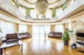 Modern Interior Of Residential House Or Hotel As Creative Abstract Blur Background. Large Hall With  poster