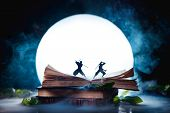 An Open Book With Two Ninja Warrior Silhouettes Fighting In Full Moon. Reader Imagination And Writin poster