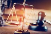 Symbols of law - gold measuring scales and courtroom gavel. Justice and trial concept. poster