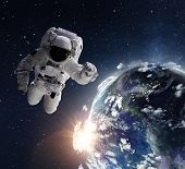 Flying astronaut operating in space nearby of planet Earth. Exploration of universe. Some elements a poster