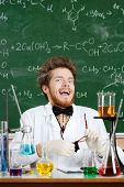 Scientist laughs madly in his laboratory