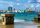 image of malecon  - The skyline of Havana with a turbulent sea and El Malecon in the foreground - JPG