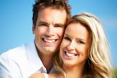 image of love couple  - Young love couple smiling under blue sky - JPG
