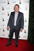 LOS ANGELES - SEP 21:  Eric Stonestreet arrives at the Primetime Emmys Performers Nominee Reception