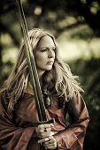 picture of valkyrie  - Beautiful blond sexy woman warrior with sword outdoor
