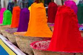 image of haldi  - Piles of colorful powdered dyes used for holi festival. An Indian shop