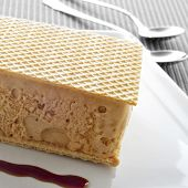 typical spanish helado al corte or corte de helado, ice cream sandwich with wafers, served with syru