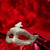 image of venetian carnival  - Vintage venetian carnival mask on red background - JPG