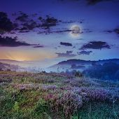 Cold Fog On Hot Sunrise In Mountains With Moon
