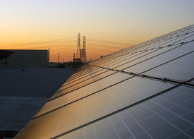 picture of power lines  - View of solar panels with electrical power lines in the background - JPG