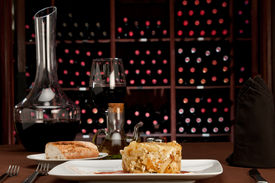 stock photo of gourmet food  - Restaurante table setting with tapa huevos rotos literally translated as  - JPG