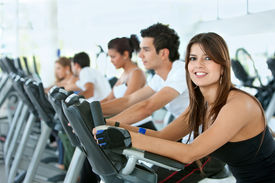 stock photo of male female  - Group of gym people exercising on cardio machines - JPG