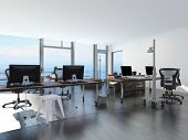 foto of workstation  - Modern waterfront office overlooking the sea with several computer workstations on movable wheeled office tables in a bright airy room with a glass view window or wall - JPG