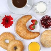 picture of bagel  - Set table with breakfast bagels marmalade coffee and orange juice from above - JPG
