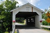 image of covered bridge  - The Fuller Bridge or Black Falls covered bridge is located in Montgomery VT - JPG