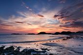 pic of bute  - Colorful sunset on the beach of Traigh Mor Isle of Iona Inner Hebrides of Scotland - JPG