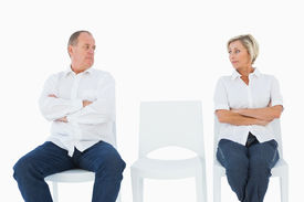 picture of not talking  - Upset couple not talking to each other after fight on white background - JPG