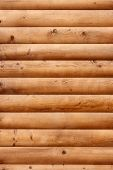 pic of log fence  - Shield with a large number of rounded parallel wooden planks as a logs - JPG