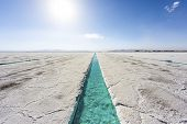 pic of salt mine  - Salt water pool on the Salinas Grandes salt flats in Jujuy province northern Argentina - JPG