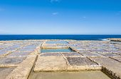 pic of gozo  - Salt evaporation ponds also called salterns or salt pans located near Qbajjar on the maltese Island of Gozo - JPG