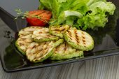 picture of zucchini  - Grilled zucchini in the bowl with salad leaves - JPG