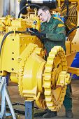 pic of assembly line  - industrial worker during heavy industry machinery assembling on production line manufacturing workshop at factory - JPG