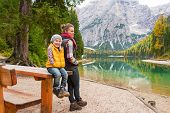 pic of south tyrol  - Portrait of mother and baby on lake braies in south tyrol italy