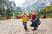 pic of south tyrol  - Portrait of happy mother and baby on lake braies in south tyrol italy