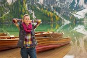 stock photo of south tyrol  - Portrait of relaxed young woman on lake braies in south tyrol italy
