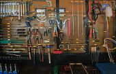 picture of lube  - hand tool kit object arrangement on car auto service and maintenance wall - JPG