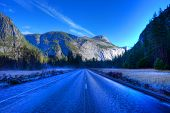 stock photo of icy road  - Icy road Yosemite Valley National Park California in autumn - JPG