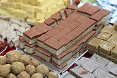 image of barfi  - Various indian sweets on the counter an market - JPG
