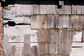 pic of shingles  - Old wood shed showing its age with broken split and
