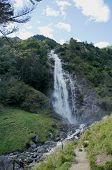 image of south tyrol  - The Parcines Waterfall on a steep mountain slope - JPG
