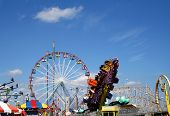 stock photo of amusement park rides  - Amusement park rides on the boardwalk at the New Jersey shore - JPG