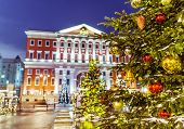 foto of municipal  - Christmas tree with balls on the background architecture of Moscow Tverskaya Square and the building of Municipality - JPG