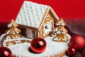 picture of gingerbread house  - Holiday Gingerbread house on red background christmas cookie - JPG
