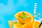 picture of mojito  - Fresh orange Mojito cocktail  with twist by the swimming pool - JPG