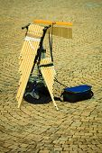 stock photo of wind instrument  - Musical wind instrument pan flute outdoor on street - JPG