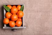 pic of sackcloth  - Fresh ripe mandarins in wooden box - JPG