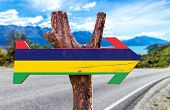 picture of mauritius  - Mauritius Flag wooden sign with road background - JPG