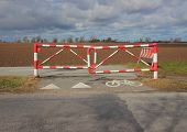 pic of safety barrier  - Bicycle Safety Barrier at Bike Lane in Red and White Stripes
