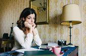 picture of entrepreneur  - Tired and overwhelmed young woman studying or working at home - JPG