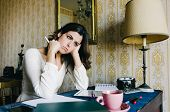 pic of entrepreneur  - Tired and overwhelmed young woman studying or working at home - JPG