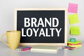 stock photo of loyalty  - Brand loyalty concept on chalkboard in office interior - JPG